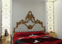 Fabulous traditional bedroom with gold nightstands and ornate design
