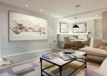 Fabulous use of wall art adds to the class of the calming living area draped in neutral hues