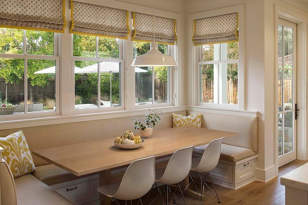 Farmhouse style banquette dining space next to the windows