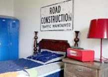 Farmhouse style kids' room with a road sign above the bed