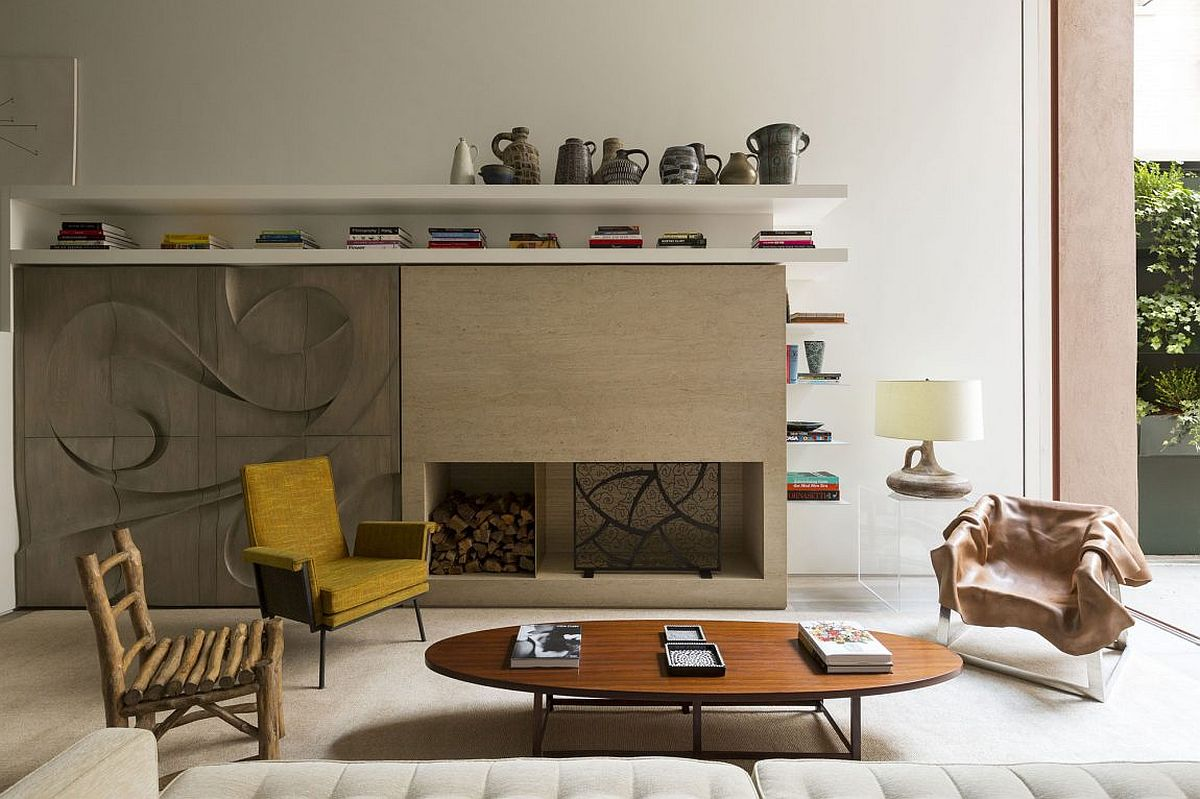 Fireplace and cabinets with sculptural millwork give the living room a unique style