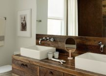 Floating wooden vanity and backsplash give the bathroom an organic twist