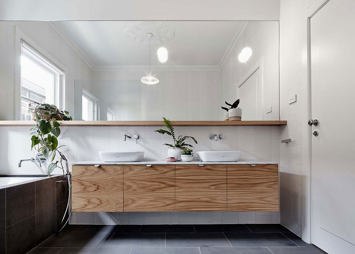 Floating wooden vanity in a contemporary bathroom in white