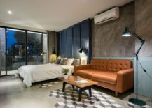 Floor design brings a touch of 3D beuaty to the bedroom and industrial modern living area