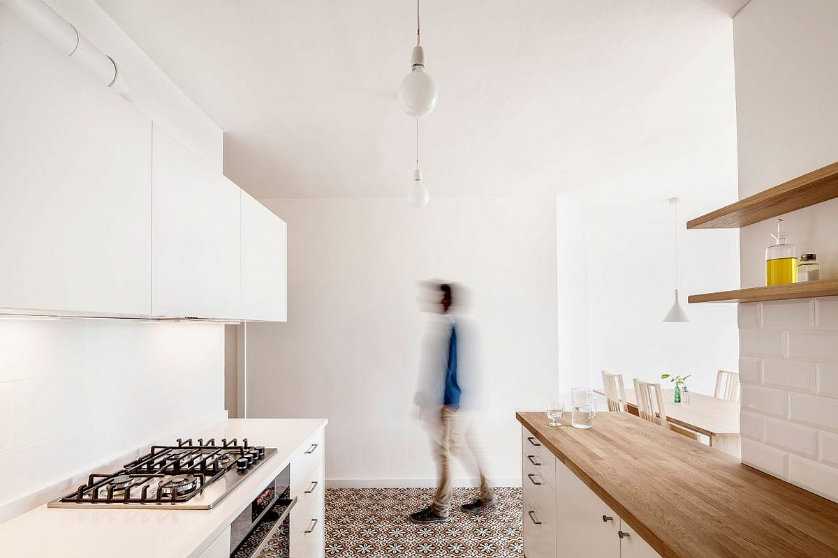 Floor in mosaic tiles adds pattern to the kitchen