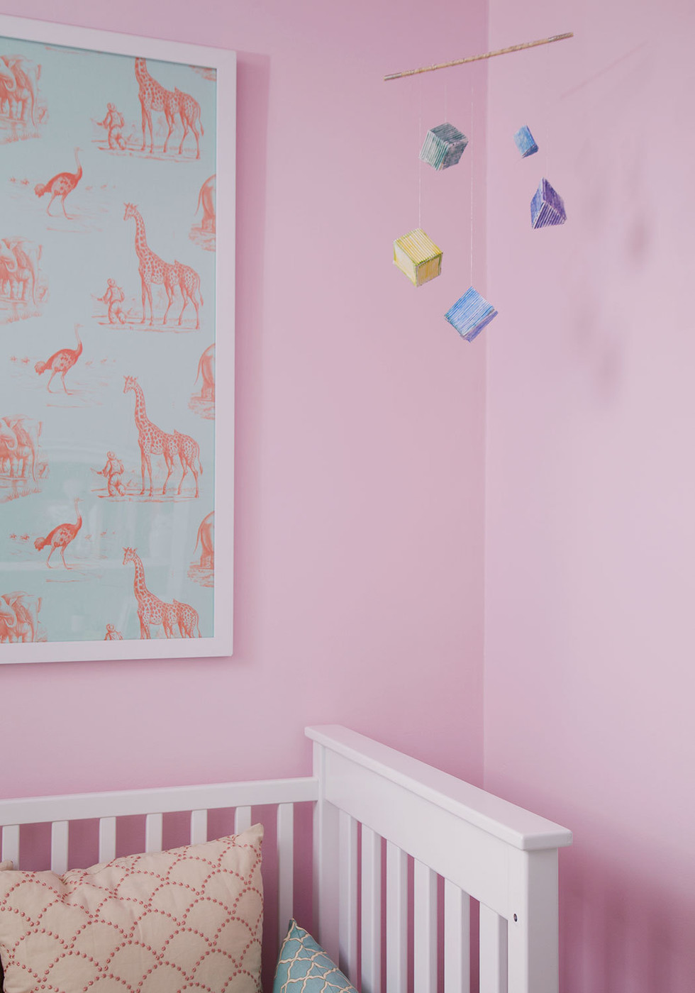 Framed wallpaper in a pink nursery