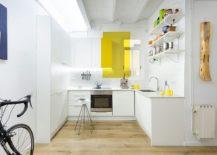 Fun way of adding yellow radiance to the small, white kitchen