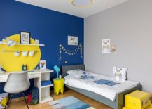 Fun way of adding yellow to a room with bright blue accent wall