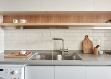Functional-kitchen-design-with-sleek-floating-shelf-and-smart-wall-mounted-cabinets-217x155