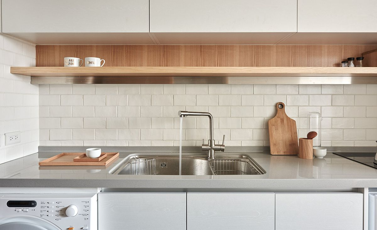 Functional kitchen design with sleek floating shelf and smart, wall-mounted cabinets