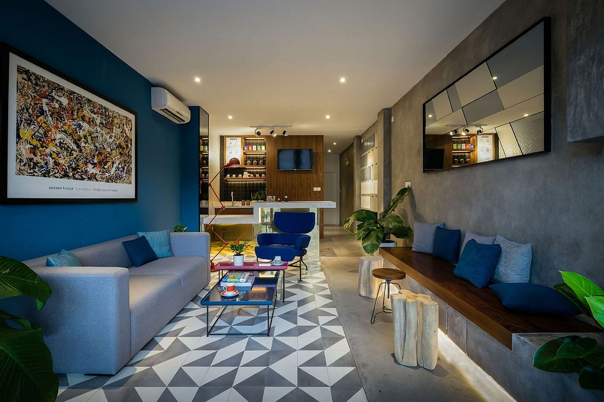 Geometric floor tiles, bold beautiful walls and exposed concrete surfaces shape the smart reception