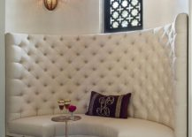 Give the dining banquette a distinct Moroccan vibe with lighting and ornate pattern