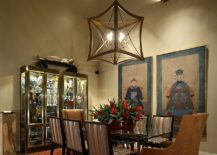 Glass cabinet display in the dining room filled with Chinese decorative pieces