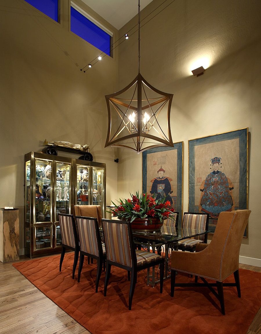 Glass cabinet display in the dining room filled with Chinese decorative pieces [Design: Culbertson Durst Interiors]