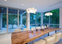 Glass doors open up the dining room to the patio and view outside [Design: ibi designs]
