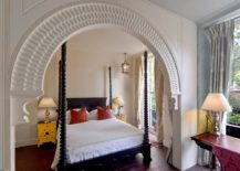 Gold bedside table becomes the focal point in this lovely Mediterranean bedroom