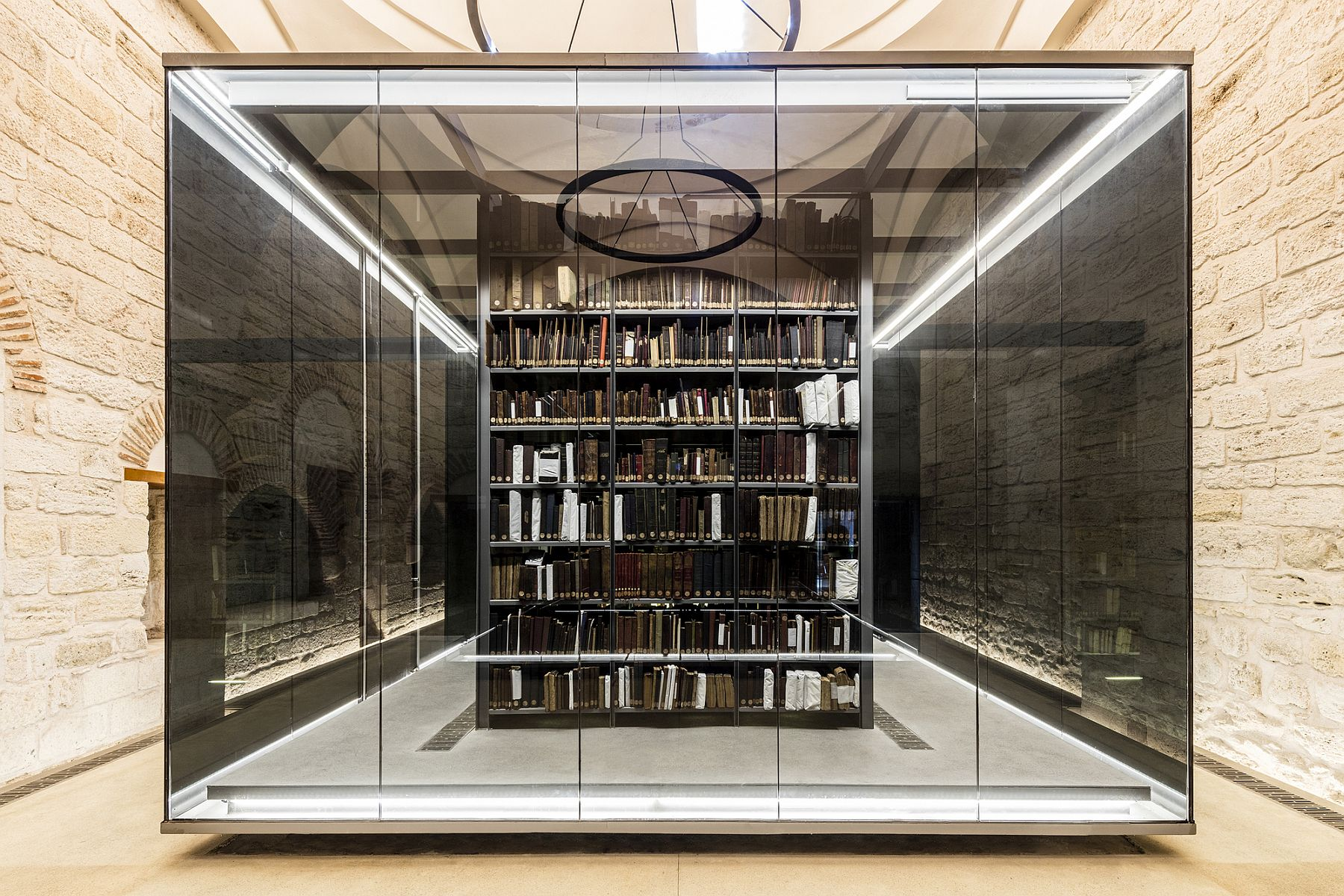 Gorgeous lit black glass boxes fit into the classic shell of the library perfectly