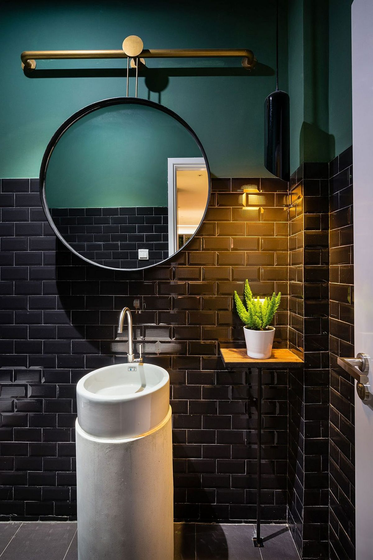 Gorgeous use of color and brass acceents in the small bathroom