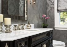 Gray and slivery gray coupled with black and white in the powder room