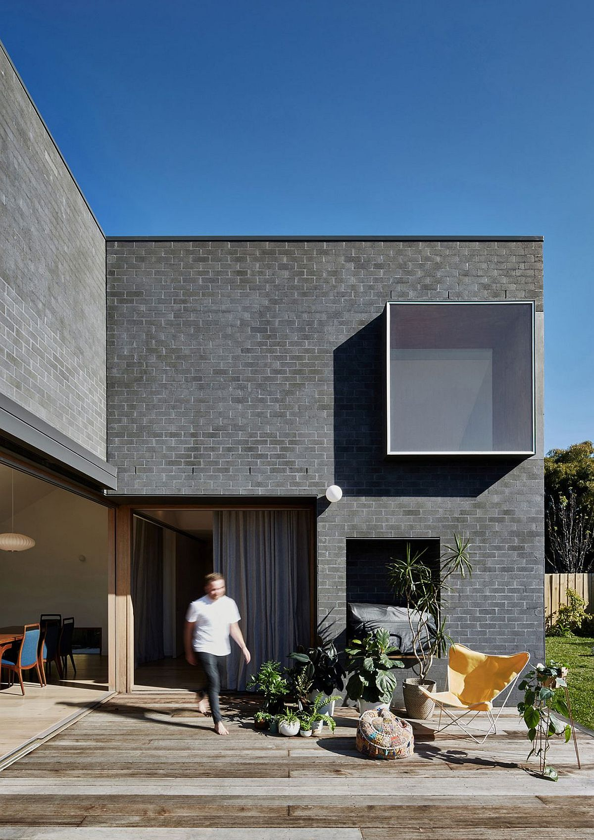 Gray brick exterior of the house gives it a modern appeal This Kid Friendly Family House Welcomes You with Bright, Open Spaces