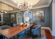 Gray dining room with mirrored wall and live edge dining table [Design: Lucy and Company]