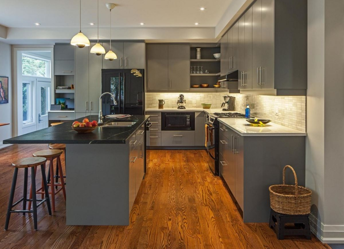 Grey kitchen with hardwood floors