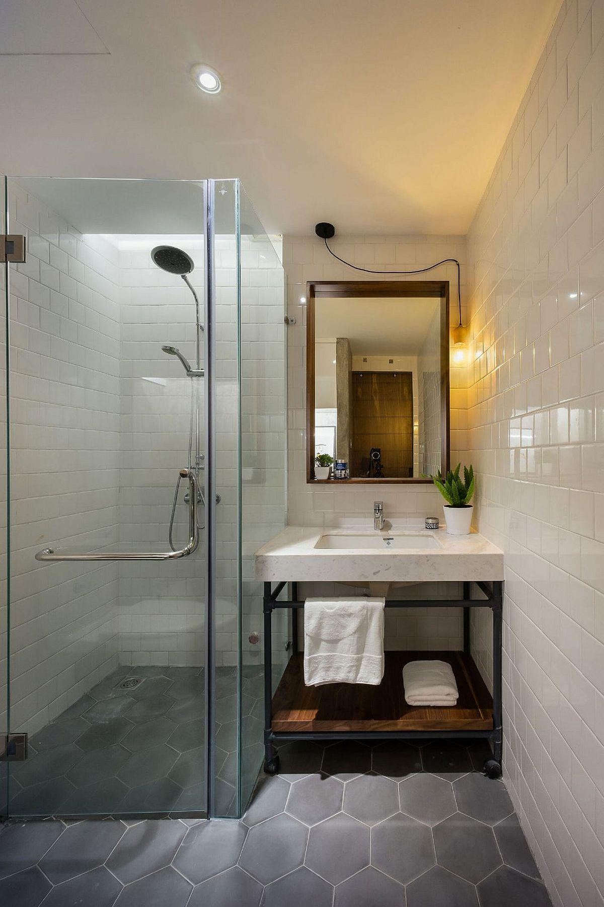 Hexagonal floor tiles bring geometric beauty to the small bathroom