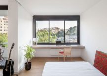 Sliding Doors Alter the Dynamics of Light-Filled Barcelona Apartment
