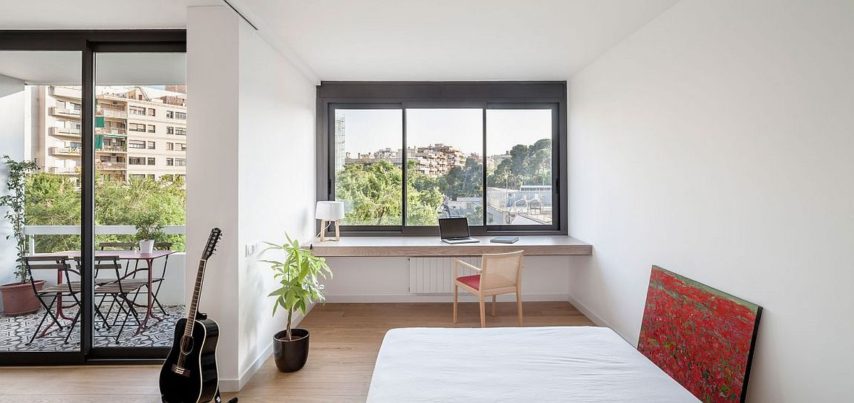 Home workspace and balcony of the cheerful apartment