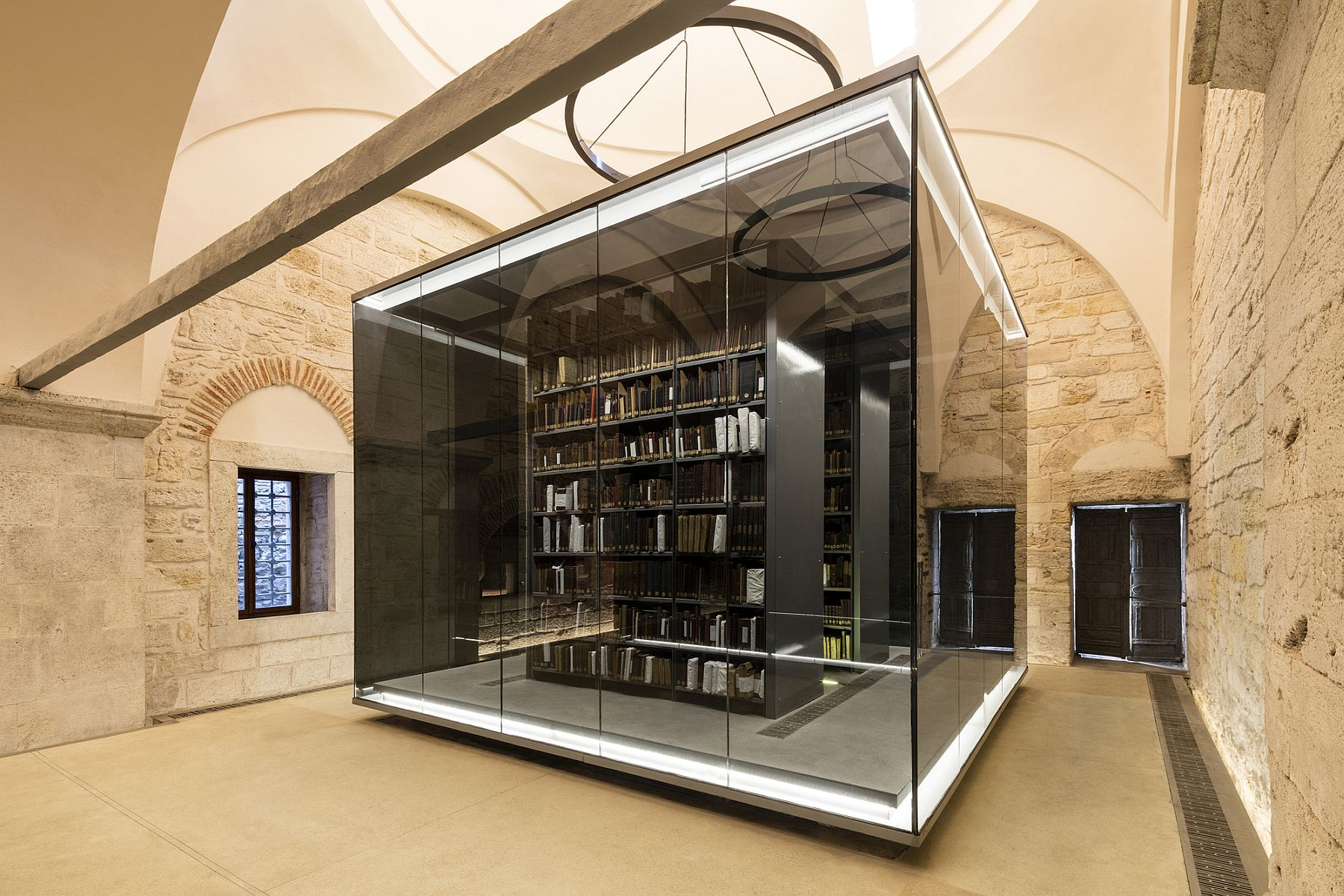 Illuminated glass boxes designed by Tabanlioglu Architects transform Istanbuls largest and oldest library Sensible and Minimal Restoration: Black Glass Boxes Alter Istanbul's Oldest Library