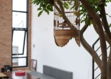 Indoor tree and cage add an interesting visual to the serene private residence