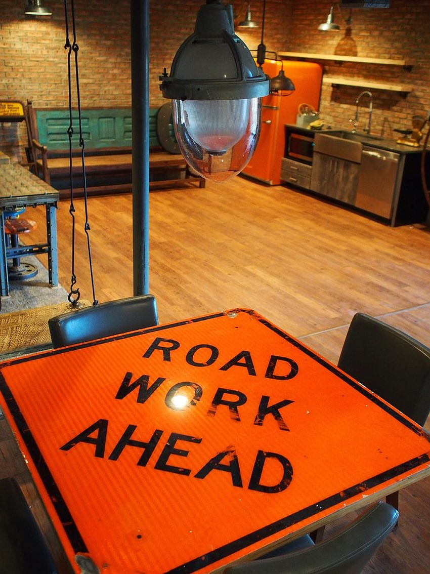Industrial dining table crafted out of a road sign and reclaimed wood [Design: rossmönster designs]