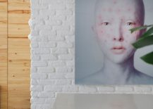 Interesting use of wall art to enliven the small, minimal interior of the RF House