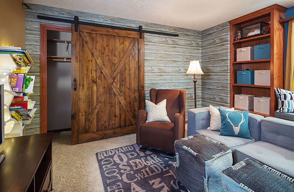Kids' media room and play area with a striking, sliding barn door