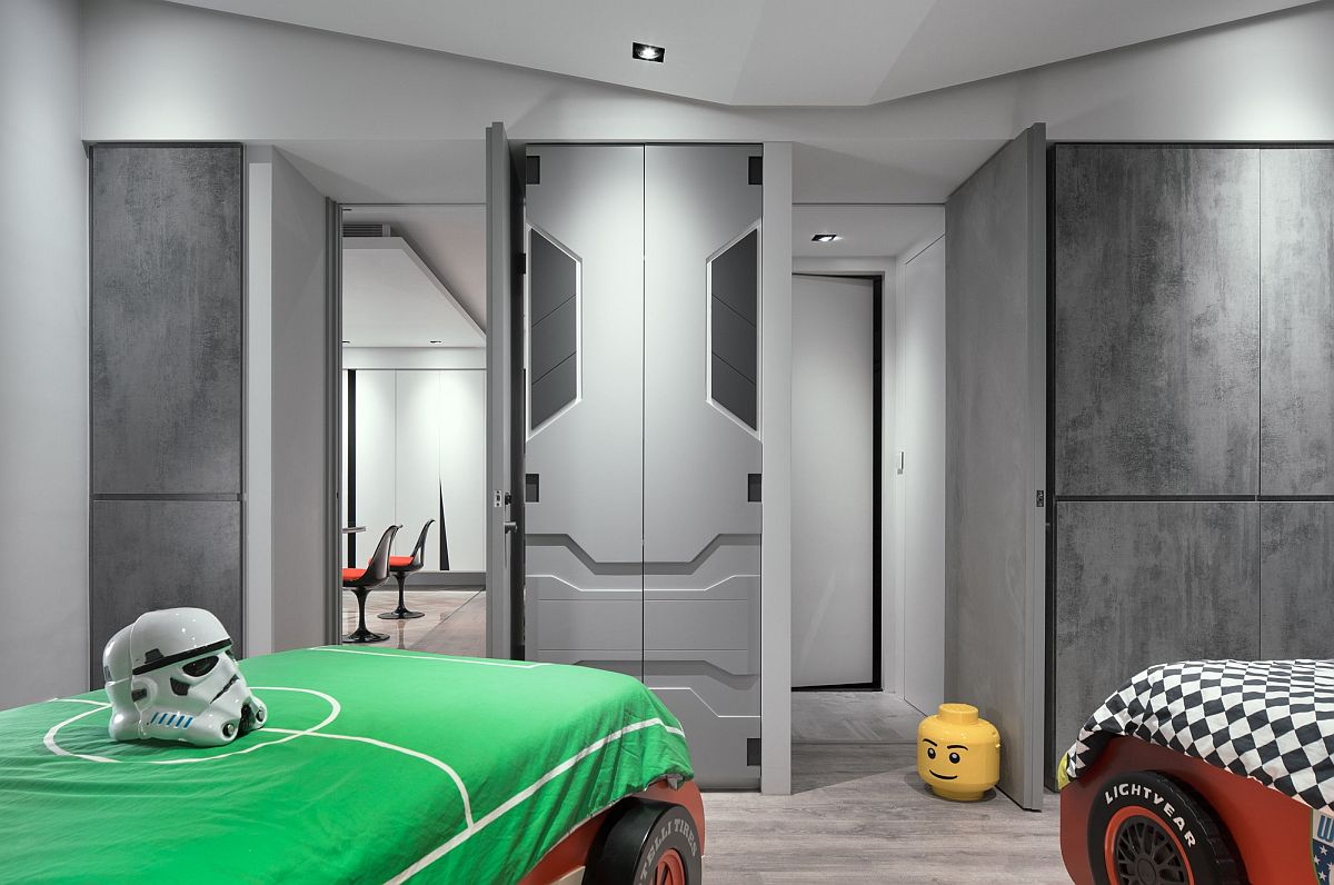 Kids' room with racing car beds and cabinets inspired by the Millennium Falcon
