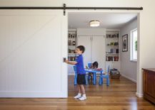 Kids' study area and playroom delineated from the rest of the home using sliding barn door