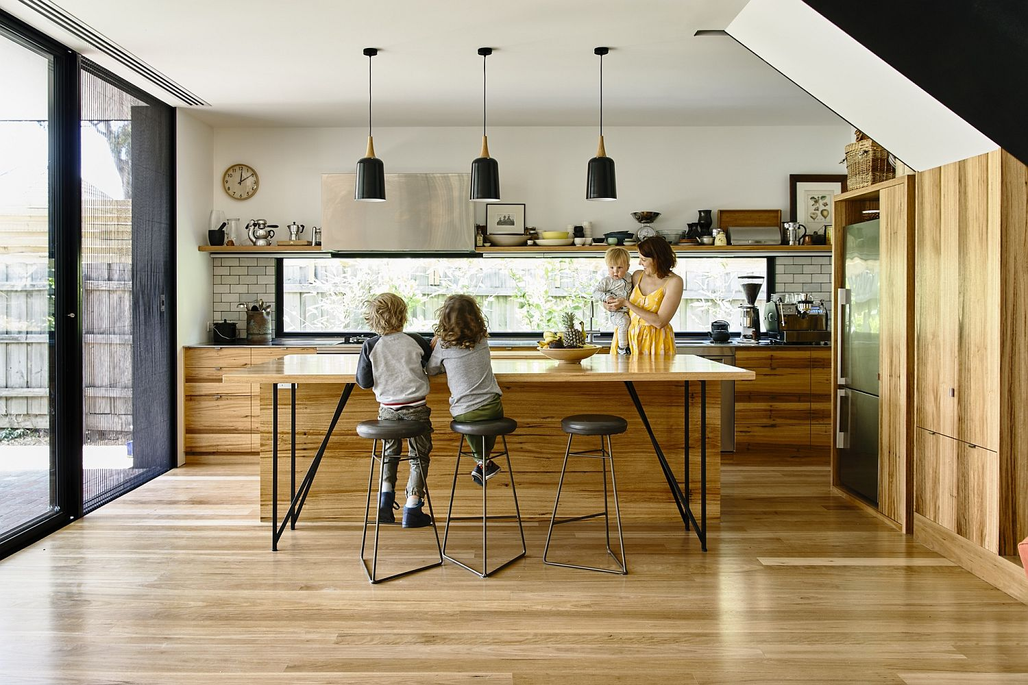 Kitchen becomes the social zone of the extended Melbourne home