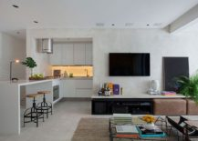 L-shaped kitchen of the small apartment is a space saver