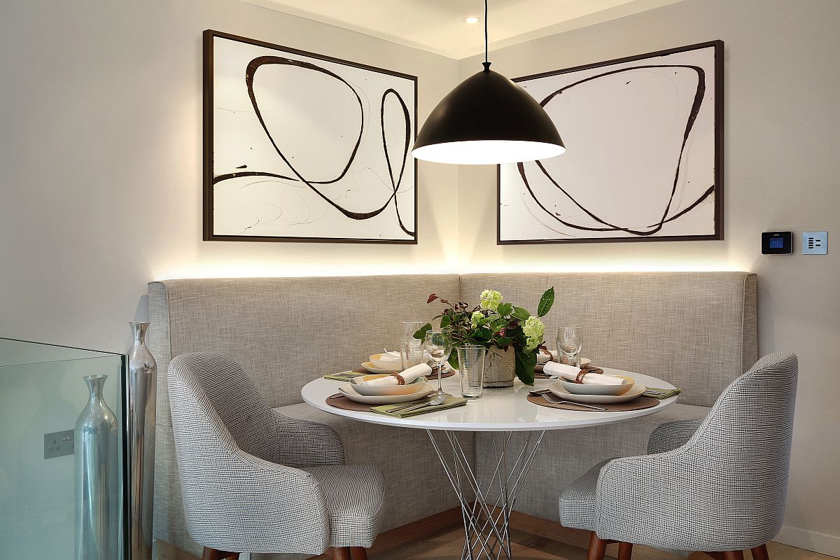 LED strip ligting and pendant lamp turn the corner banquette dining into a cheerful and visually spacious setting