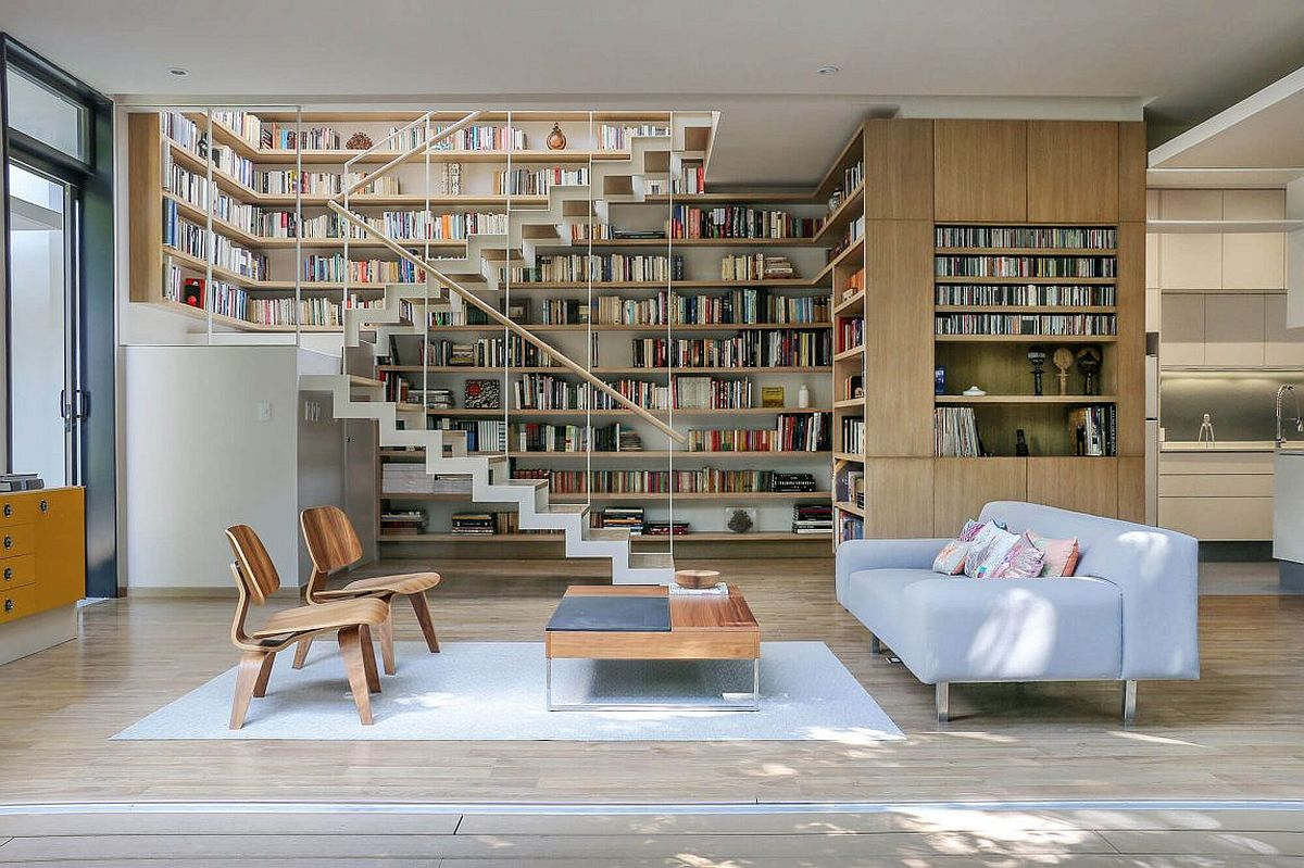 Large booksehlf turns the staircase wall into an aesthetic and practical addition