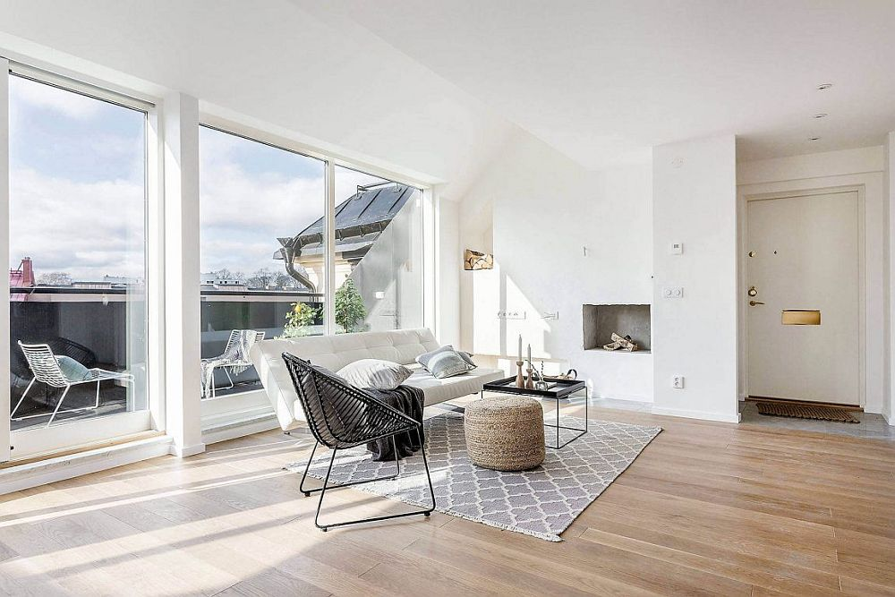 Large sliding doors bring ample natural light into the Stockholm apartment