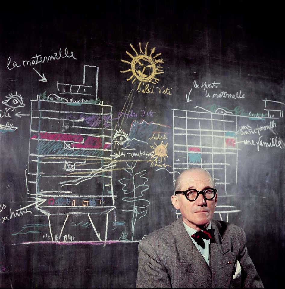 Le Corbusier in front of a section drawing of his Unité d'Habitation. Photographed in 1953 by Willy Rizzo. Image via Fast Company.