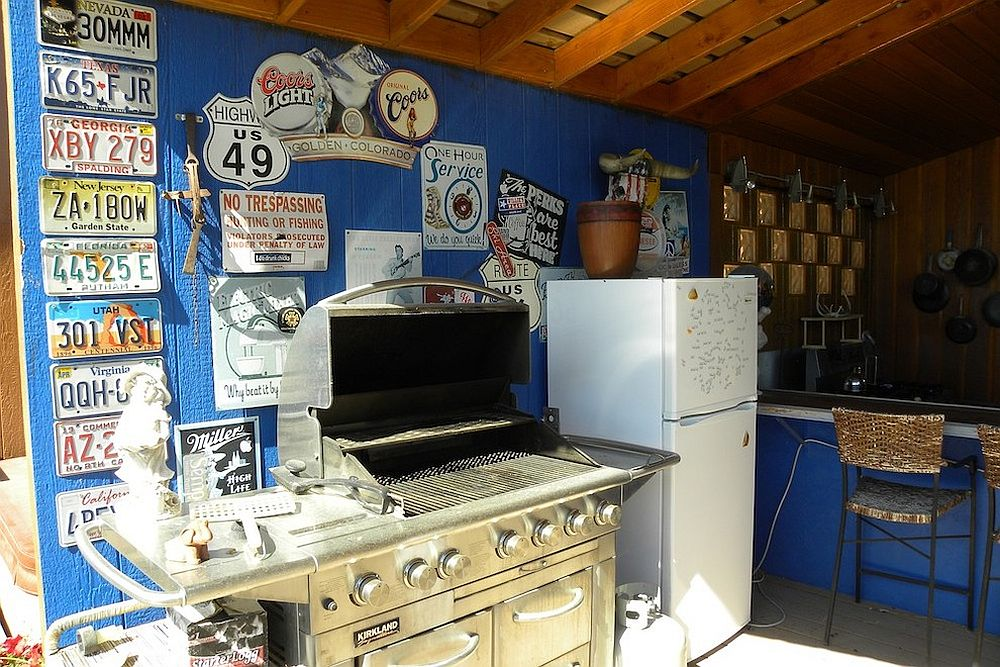 License plates and street signs add unique personality to eclectic kitchen