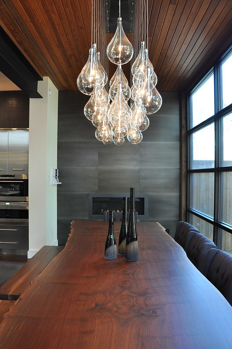 Lighting steals the show in this dining room [Design: Smith & Ragsdale Kitchen Design]
