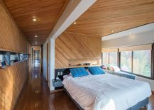 Long corridor connects the two wings on the top level of the stylish Chilean home