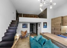 Look at the living area and mezzanine level of the ultra small apartment in Kiev