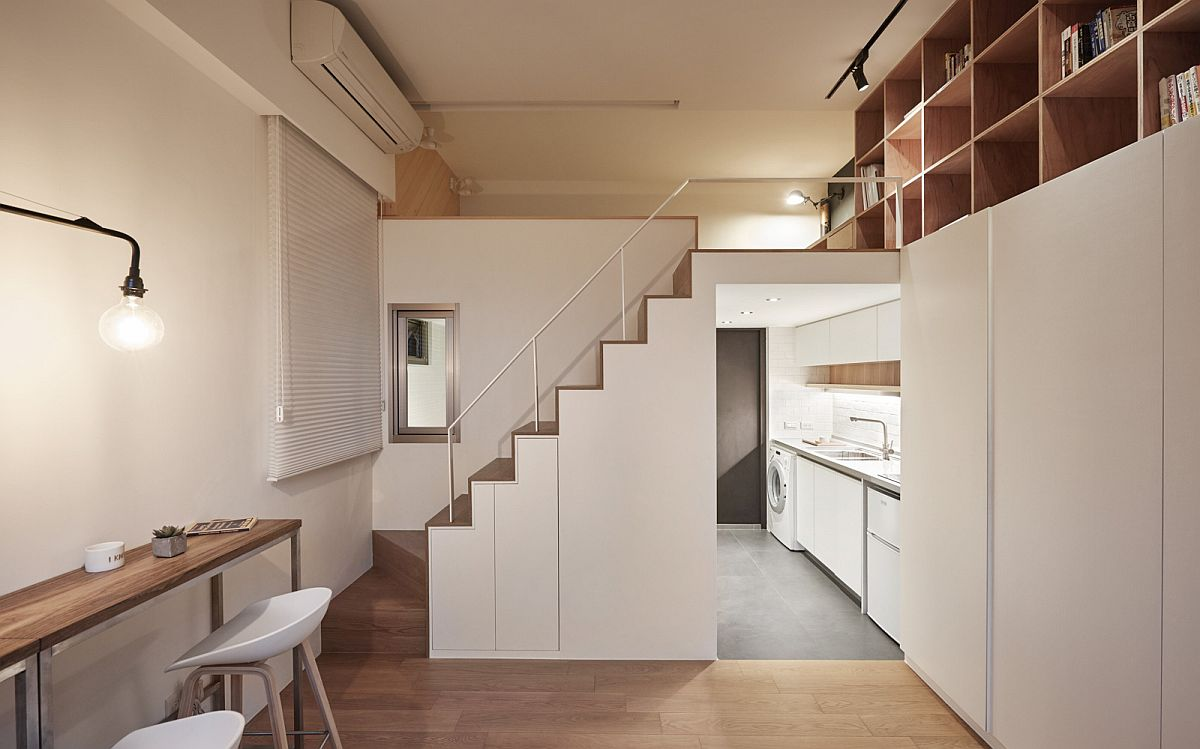 Look at the small kitchen, living are and mezzanine level of the tiny apartment