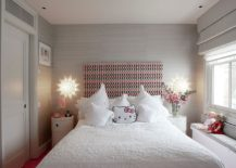 Lovely Hello Kitty pillow perfectly complements the white and pink color scheme of the kids' bedroom