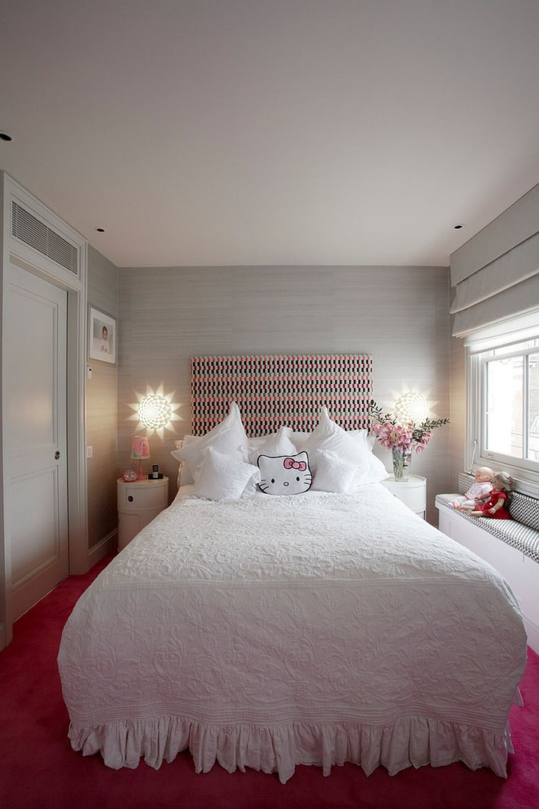 Lovely Hello Kitty pillow perfectly complements the white and pink color scheme of the kids' bedroom [Design: TLA Studio aka Trevor Lahiff Architects]