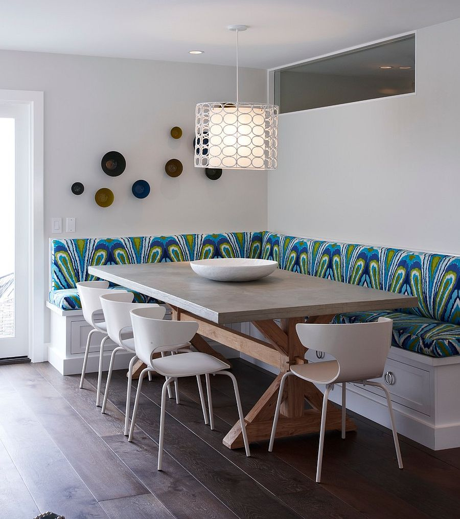 Lovely ligting and colorful seating define a fabulous banquette dining